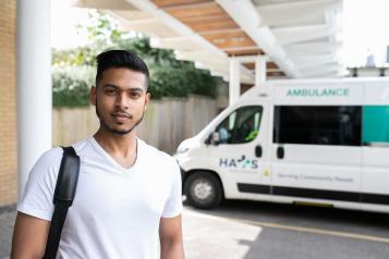 young man standing near a ambulance