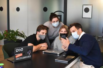 people in a business meeting wearing masks