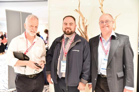 Three Healthwatch volunteers at an event