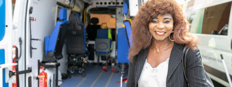 Woman stood at the back of an ambulance