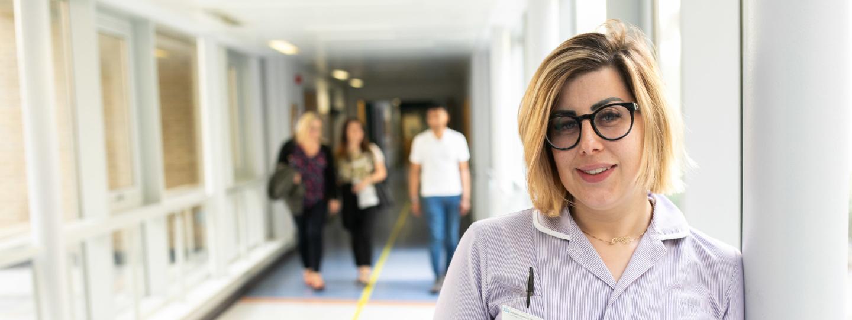 Nurse stood in a hospital corridor